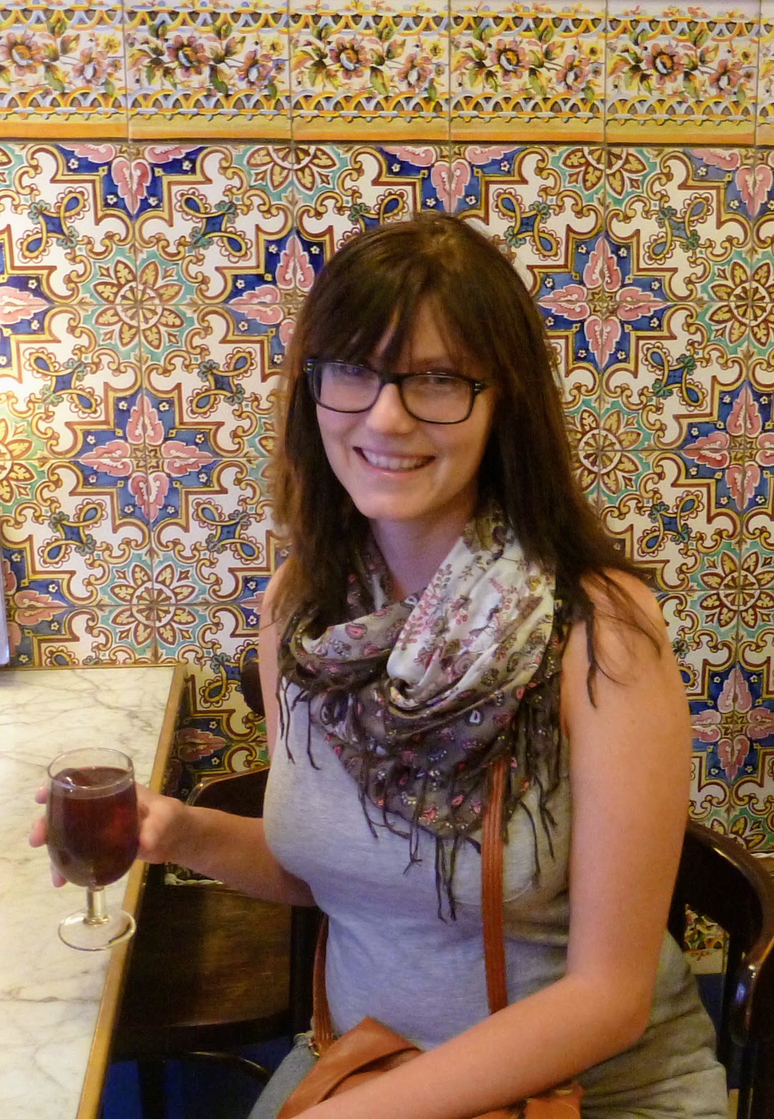 picture of Sam in a cafe drinking sangria